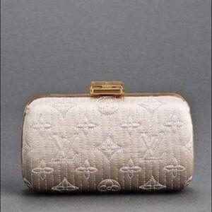 Louis Vuitton Clutch.